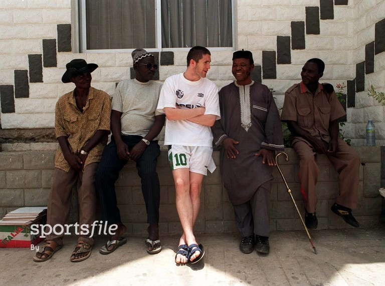 30 March 1999; (centre) Robbie Keane, Republic of Ireland, talks to locals in Ibadan, Nigeria. FIFA World Cup U-20 tournament. Soccer. Picture credit; David Maher/SPORTSFILE