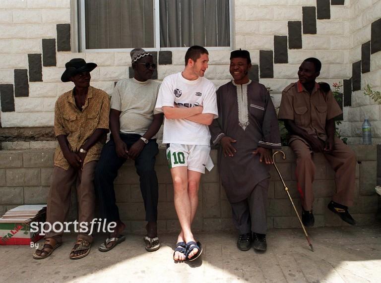30 March 1999; (centre) Robbie Keane, Republic of Ireland, talks to locals in Ibadan, Nigeria. FIFA World Cup U-20 tournament. Soccer. Picture credit; David Maher/SPORTSFILE