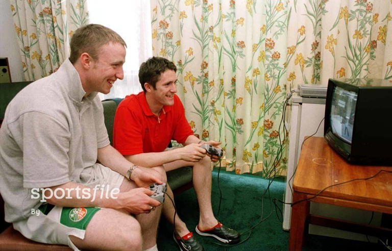 30 March 1999; Republic of Ireland's Gerry Crossley, left, and Robbie Keane get in some playstation practice in their hotel room between training sessions. Premier Hotel.  Ibadan, Nigeria. Soccer. Picture credit; David Maher/SPORTSFILE