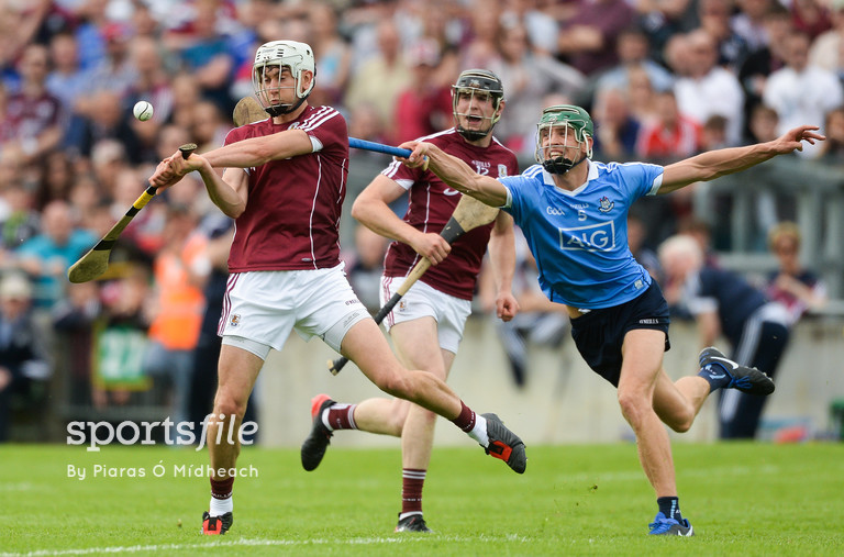 28 May 2017; Jason Flynn of Galway, supported by team-mate Joseph Cooney, behind, in action against Chris Crummey of Dublin during the Leinster GAA Hurling Senior Championship Quarter-Final match between Galway and Dublin at O'Connor Park, in Tullamore, Co. Offaly.  Photo by Piaras Ó Mídheach/Sportsfile