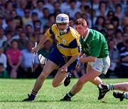 16 June 1996; Ger O'Loughlin of Clare in action against Ciaran Carey of Limerick during the Munster GAA Hurling Senior Championship Semi-Final match between Limerick and Clare at Gaelic Grounds in Limerick. Photo by Ray McManus/Sportsfile