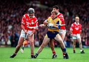 8 June 1997; James O'Connor of Clare in action against Sean OG O'hAilpin, left, and Brian Corcoran of Cork during the GAA Hurling Munster Senior Championship Semi-Final match between Clare and Cork at Gaelic Grounds, in Limerick. Photo by Ray McManus/Sportsfile