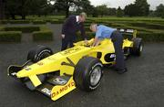 29 July 2003; An Post employees Noel Quinn and Conor Kirwan at the launch of the Swiftpost Phoenix Park Motor Races. This year marks the centenary of the event and will be held on the 16th and 17th of August. Picture credit; Ray McManus / SPORTSFILE *EDI*