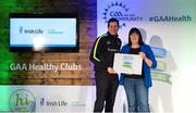 4 November 2017; Mary Maloney, representing Ballinderreen GAA, Co Galway, is presented with the Official Healthy Club Award by Seán Cavanagh, Healthy Clubs Ambassador and former Tyrone Footballer. The special ceremony held in Croke Park saw 58 GAA clubs recognised as the first official 'Healthy Clubs' on the island of Ireland. The GAA's Healthy Clubs Project hopes to transform GAA clubs nationally into hubs for community health and wellbeing. As part of the programme, each club is trained to deliver advice and information programmes on a variety of different topics including, physical activity; emotional wellbeing; healthy eating; community development, to name but a few. For more information, visit: www.gaa.ie/community. Croke Park, Dublin. Photo by Piaras Ó Mídheach/Sportsfile