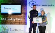4 November 2017; Melissa Conlon representing Castleblaney Faughs, Co Monaghan, is presented with the Official Healthy Club Award by Seán Cavanagh, Healthy Clubs Ambassador and former Tyrone Footballer. The special ceremony held in Croke Park saw 58 GAA clubs recognised as the first official 'Healthy Clubs' on the island of Ireland. The GAA's Healthy Clubs Project hopes to transform GAA clubs nationally into hubs for community health and wellbeing. As part of the programme, each club is trained to deliver advice and information programmes on a variety of different topics including, physical activity; emotional wellbeing; healthy eating; community development, to name but a few. For more information, visit: www.gaa.ie/community. Croke Park, Dublin. Photo by Piaras Ó Mídheach/Sportsfile