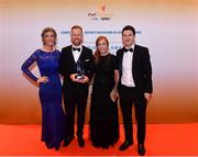 3 November 2017; Carlow hurler Richard Coady with, from left, Dierdre Thomlinson, Marie Coady, and Mark Berry after collecting his Christy Ring Champion 15 Award during the PwC All Stars 2017 at the Convention Centre in Dublin. Photo by Sam Barnes/Sportsfile