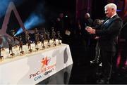 3 November 2017; Uachtarán Chumann Lúthchleas Gael Aogán Ó Fearghail takes a photo of the All Star awards prior to the start of the PwC All Stars 2017 at the Convention Centre in Dublin. Photo by Brendan Moran/Sportsfile