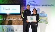 4 November 2017; Bríd Mimnagh, representing Dromard GAA, Co Longford, is presented with the Official Healthy Club Award by Seán Cavanagh, Healthy Clubs Ambassador and former Tyrone Footballer. The special ceremony held in Croke Park saw 58 GAA clubs recognised as the first official 'Healthy Clubs' on the island of Ireland. The GAA's Healthy Clubs Project hopes to transform GAA clubs nationally into hubs for community health and wellbeing. As part of the programme, each club is trained to deliver advice and information programmes on a variety of different topics including, physical activity; emotional wellbeing; healthy eating; community development, to name but a few. For more information, visit: www.gaa.ie/community. Croke Park, Dublin. Photo by Piaras Ó Mídheach/Sportsfile