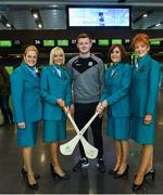 17 November 2017; Galway hurlers departed Dublin Airport for Boston today onboard Aer Lingus flight EI137. Aer Lingus, official airline of the AIG Fenway Hurling Classic and Irish Festival, has been serving Boston since 1958 and is thrilled to once again be supporting this unique cultural and sporting event, bringing 130 hurlers to Boston's iconic Fenway Park. Games will be broadcast on TG4 on November 19th with Dublin v Galway in the first semi-final followed by Clare v Tipperary in the second semi-final. Pictured is Galway hurler Joe Canning with Aer Lingus cabin crew, from left, Monica Bermejo, Doreen Crotty, Jackie Bailey and Olive Bohan. Photo by Ramsey Cardy/Sportsfile