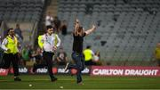 18 November 2017; A man who ran on to the pitch after the game is pursued by security personnel after the Virgin Australia International Rules Series 2nd test at the Domain Stadium in Perth, Australia. Photo by Ray McManus/Sportsfile
