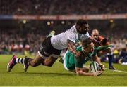 18 November 2017; Dave Kearney of Ireland scores his side's second try despite the tackle of Timoci Nagusa of Fiji during the Guinness Series International match between Ireland and Fiji at the Aviva Stadium in Dublin. Photo by Seb Daly/Sportsfile