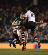 18 November 2017; Chris Farrell of Ireland is tackled by Ben Volavola, right, and Dominiko Waqaniburotu of Fiji, behind, during the Guinness Series International match between Ireland and Fiji at the Aviva Stadium in Dublin. Photo by Seb Daly/Sportsfile