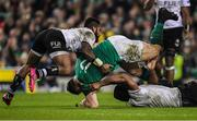 18 November 2017; Cian Healy of Ireland is tackled by Ben Volavola, left and Dominiko Waqaniburotu of Fiji during the Guinness Series International match between Ireland and Fiji at the Aviva Stadium in Dublin. Photo by Eóin Noonan/Sportsfile