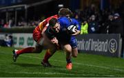 24 November 2017; Rory O'Loughlin of Leinster scores his side's eighth try despite the best efforts of Jack Dixon of Dragons during the Guinness PRO14 Round 9 match between Leinster and Dragons at the RDS Arena in Dublin. Photo by Brendan Moran/Sportsfile