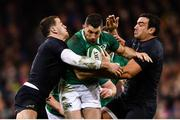 25 November 2017; Rob Kearney of Ireland is tackled by Agustin Creevy, left, and Emiliano Boffelli of Argentina during the Guinness Series International match between Ireland and Argentina at the Aviva Stadium in Dublin. Photo by Ramsey Cardy/Sportsfile