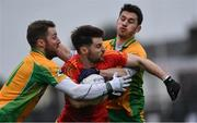 26 November 2017; Donie Newcombe of Castlebar Mitchels is tackled by Micheál Lundy, left, and Ian Burke of Corofin during the AIB Connacht GAA Football Senior Club Championship Final match between Corofin and Castlebar Mitchels at Tuam Stadium in Tuam, Galway. Photo by Ramsey Cardy/Sportsfile