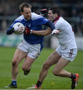 26 November 2017; Sean Johnston of Cavan Gaels in action against Karl McKaigue of Slaughtneil during the AIB Ulster GAA Football Senior Club Championship Final match between Slaughtneil and Cavan Gaels at the Athletic Grounds in Armagh. Photo by Oliver McVeigh/Sportsfile