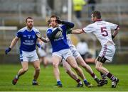 26 November 2017; Sean Johnston of Cavan Gaels in action against Francis McEldowney of Slaughtneil during the AIB Ulster GAA Football Senior Club Championship Final match between Slaughtneil and Cavan Gaels at the Athletic Grounds in Armagh.