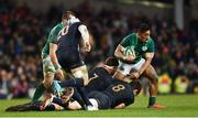 25 November 2017; Bundee Aki of Ireland is tackled by Marcos Kremer, left, and Tomas Lezana of Argentina during the Guinness Series International match between Ireland and Argentina at the Aviva Stadium in Dublin. Photo by Ramsey Cardy/Sportsfile