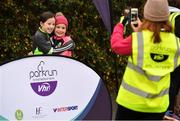 3 December 2017; Jane, left, and Ruth Lynch, from Tralee, Co. Kerry, have their picture taken by their mother Caroline, before taking part in the parkrun Ireland event in Deerpark, Mount Merrion, Dublin. parkrun Ireland in partnership with Vhi, expanded their range of junior events to thirteen with the introduction of the Deerpark junior parkrun on Sunday, December 3rd. Junior parkruns are 2km long and cater for 4 to 14 year olds, free of charge providing a fun and safe environment for children to enjoy exercise. To register for a parkrun near you visit www.parkrun.ie. Photo by Brendan Moran/Sportsfile