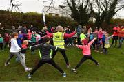 3 December 2017; Volunteer Caroline Lynch, from Tralee, Co. Kerry, leads the participants in a warm-up before they take part in the parkrun Ireland event in Deerpark, Mount Merrion, Dublin. parkrun Ireland in partnership with Vhi, expanded their range of junior events to thirteen with the introduction of the Deerpark junior parkrun on Sunday, December 3rd. Junior parkruns are 2km long and cater for 4 to 14 year olds, free of charge providing a fun and safe environment for children to enjoy exercise. To register for a parkrun near you visit www.parkrun.ie. Photo by Brendan Moran/Sportsfile
