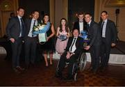 2 December 2017; Dublin captain Stephen Cluxton, together with Denis Bastic, Paul Flynn, Allison, Eva, Conail and Shane Carthy makes a presentation to Antrim senior football captain Anto Finnegan who was the guest of honour at the All-Ireland medal presentation in the InterContinental Dublin in Ballsbridge, Dublin. Photo by Ray McManus/Sportsfile