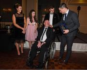 2 December 2017; Dublin captain Stephen Cluxton, together with Allison, Eva and Conail makes a presentation to Antrim senior football captain Anto Finnegan who was the guest of honour at the  All-Ireland medal presentation in the InterContinental Dublin in Ballsbridge, Dublin. Photo by Ray McManus/Sportsfile