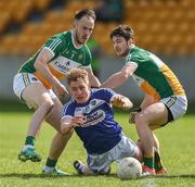 "2 April 2017; David Conway of Laois in action against Graham Guilfoyle and Daithi Brady of Offaly during the Allianz Football League Division 3 Round 7 match between Offaly and Laois at O'Connor Park in Tullamore, Co Offaly. Photo by David Maher/Sportsfile  This image may be reproduced free of charge when used in conjunction with a review of the book ""A Season of Sundays 2017"". All other usage © SPORTSFILE"