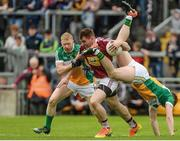 "11 June 2017; Kieran Martin of Westmeath in action against Seán Pender and Niall Darby, left, of Offaly during the Leinster GAA Football Senior Championship Quarter-Final match between Offaly and Westmeath at Bord Na Móna O'Connor Park, Tullamore, in Co. Offaly. Photo by Piaras Ó Mídheach/Sportsfile    This image may be reproduced free of charge when used in conjunction with a review of the book ""A Season of Sundays 2017"". All other usage © SPORTSFILE"