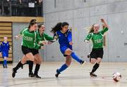 05 December 2017; Sophie Murphy of Carndonagh Community College, Co. Donegal, shoots to score her side's first goal despite the attention of Sophie Thompson, Claragh Callanan, and Lya Gilooly of Presentation Secondary School, Ballpheane, Co. Cork, during the FAI Post Primary Schools Futsal Finals at Waterford IT Indoor Arena in Waterford.  Photo by Seb Daly/Sportsfile