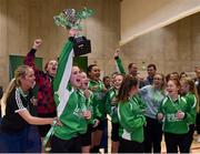 05 December 2017; Captain of Presentation Secondary School, Ballyphehane, Co. Cork, Alix Mendez lifts the trophy following her side's victory during the FAI Post Primary Schools Futsal Finals at Waterford IT Indoor Arena in Waterford.  Photo by Seb Daly/Sportsfile