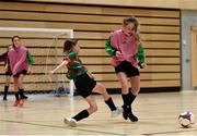 05 December 2017; Claragh Callanan of Presentation Secondary School, Ballyphehane, Co. Cork, in action against Katie Collins Byrne of St. Leo's College, Co. Carlow, during the FAI Post Primary Schools Futsal Finals at Waterford IT Indoor Arena in Waterford.  Photo by Seb Daly/Sportsfile