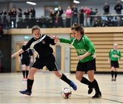 05 December 2017; Sophie Thompson of Presentation Secondary School, Ballyphehane, Co. Cork, in action against Leah Walsh of St. Attracta's Community School, Tubbercurry, CO. Sligo, during the FAI Post Primary Schools Futsal Finals at Waterford IT Indoor Arena in Waterford.  Photo by Seb Daly/Sportsfile