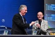 6 December 2017; Chairman of the UEFA Youth and Amateur Football Committee John Delaney, in the company of captain of the Ireland Regions Cup team Kenneth Hoey draws out the name of Republic of Ireland during the UEFA Regions Cup 2018/19 Qualifying Round draw at UEFA Headquarters, The House of European Football in Nyon, Switzerland. Photo by Sportsfile