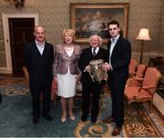 8 December 2017; Galway's Johnny Coen, carrying the Liam MacCarthy Cup, and manager Micheál Donoghue are welcomed by the President of Ireland Michael D Higgins and his wife Sabina during the GAA Hurling All-Ireland Senior & Minor Champions visit to Áras an Uachtaráin in Phoenix Park, Dublin. Photo by Stephen McCarthy/Sportsfile