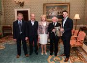 8 December 2017; Galway's Johnny Coen, carrying the Liam MacCarthy Cup, manager Micheál Donoghue and Pat Keraney, Galway County Board, left, are welcomed by the President of Ireland Michael D Higgins and his wife Sabina during the GAA Hurling All-Ireland Senior & Minor Champions visit to Áras an Uachtaráin in Phoenix Park, Dublin. Photo by Stephen McCarthy/Sportsfile