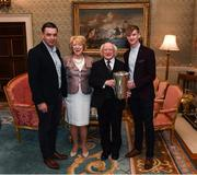 8 December 2017; Galway minor captain Darren Morrissey, accompanied by the The Irish Press Cup, and manager Jeffrey Lynskey, are welcomed by the President of Ireland Michael D Higgins and his wife Sabina during the GAA Hurling All-Ireland Senior & Minor Champions visit to Áras an Uachtaráin in Phoenix Park, Dublin. Photo by Stephen McCarthy/Sportsfile