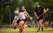9 December 2017; Dathí Burke of 2016 PwC All Star Team in action against Noel Connors, left, and Matthew O'Hanlon of 2017 PwC All Star Team during the PwC All Star Tour 2017 - All Star Hurling game at the Singapore Recreation Club, The Pandang, in Singapore. Photo by Ray McManus/Sportsfile