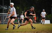 9 December 2017; Noel Connors of 2017  PwC All Star Team in action against Padraic Dineen playing with the 2016  PwC All Star Team during the PwC All Star Tour 2017 - All Star Hurling game at the Singapore Recreation Club, The Pandang, in Singapore. Photo by Ray McManus/Sportsfile
