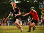 9 December 2017; Conor Whelan of 2017  PwC All Star Team in action against the 2016 PwC All Star Team goalkeeper Eoin Murphy during the PwC All Star Tour 2017 - All Star Hurling game at the Singapore Recreation Club, The Pandang, in Singapore. Photo by Ray McManus/Sportsfile