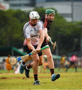 9 December 2017; Patrick Bonner Maher of 2016 PwC All Star Team in action against Noel McGrath of 2017 PwC All Star Team during the PwC All Star Tour 2017 - All Star Hurling game at the Singapore Recreation Club, The Pandang, in Singapore. Photo by Ray McManus/Sportsfile