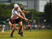 9 December 2017; Patrick Bonner Maher of 2016 PwC All Star Team in action against Noel McGrath of 2017 PwC All Star Team during the PwC All Star Tour 2017 - All Star Hurling game at the Singapore Recreation Club, The Padang, in Singapore. Photo by Ray McManus/Sportsfile
