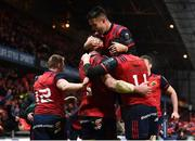 9 December 2017; Peter O'Mahony is congratulated by his Munster team-mates, including Conor Murray, top, after scoring his side's third try during the European Rugby Champions Cup Pool 4 Round 3 match between Munster and Leicester Tigers at Thomond Park in Limerick. Photo by Stephen McCarthy/Sportsfile