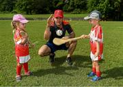 10 December 2017; GPA President David Collins with Isabelle Smith, 3 years, and Sean O'Brien during a coaching session and end of season medal presentations at the Singapore Gaelic Lions GAA training session at The Grandstand, Turf Club Rd, Bukit Timah, Singapore  Photo by Ray McManus/Sportsfile