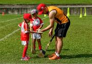 10 December 2017;  Richie Hogan of Kilkenny with Anna Mcnamara, four years and Cameron Kernaghan, 4 1/2 years, during a coaching session and end of season medal presentations at the Singapore Gaelic Lions GAA training session at The Grandstand, Turf Club Rd, Bukit Timah, Singapore  Photo by Ray McManus/Sportsfile