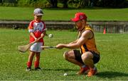 10 December 2017;  Richie Hogan of Kilkenny with Cameron Kernaghan, 4 1/2 years, during a coaching session and end of season medal presentations at the Singapore Gaelic Lions GAA training session at The Grandstand, Turf Club Rd, Bukit Timah, Singapore  Photo by Ray McManus/Sportsfile