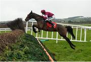 10 December 2017; A Toi Phil, with Keith Donoghue up, jump the steeplechase during their first time round during the John Durkan Memorial Punchestown Steeplechase at Punchestown Racecourse in Naas, Co Kildare. Photo by Cody Glenn/Sportsfile