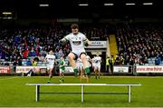 17 December 2017; Daryl Flynn of Moorefield jumps over the bench before the team photograph before the AIB Leinster GAA Football Senior Club Championship Final match between Moorefield and St Loman's at O'Moore Park in Portlaoise, Co Laois. Photo by Piaras Ó Mídheach/Sportsfile