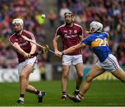 6 August 2017; Joe Canning of Galway, under pressure from Niall O'Meara of Tipperary, hits over what proved to be the winning point in the last minute of the GAA Hurling All-Ireland Senior Championship Semi-Final match between Galway and Tipperary at Croke Park in Dublin. Photo by Ray McManus/Sportsfile