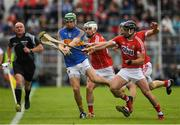 21 May 2017; Noel McGrath of Tipperary in action against Colm Spillane, Shane Kingston and Bill Cooper of Cork during the Munster GAA Hurling Senior Championship Semi-Final match between Tipperary and Cork at Semple Stadium in Thurles, Co Tipperary. Photo by Ray McManus/Sportsfile